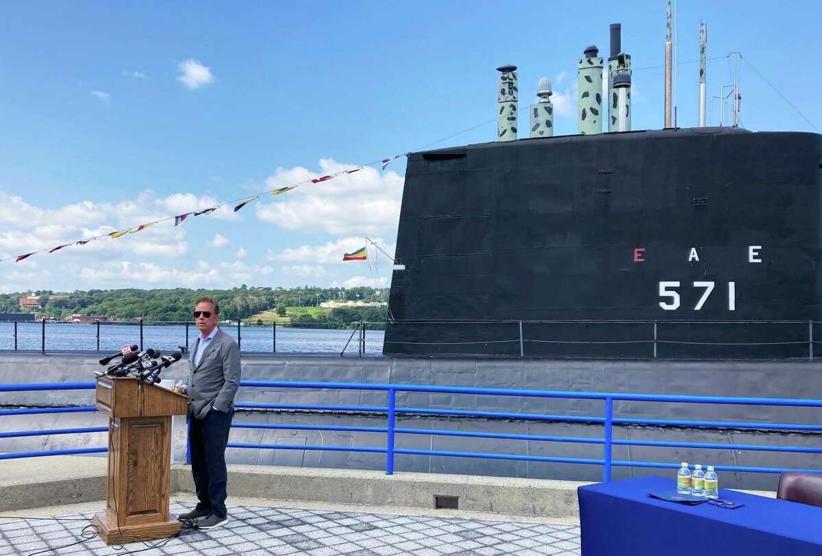 Gov. Ned Lamont in early August 2021 at the Submarine Force Museum in Groton, Conn, a short distance up the Thames River from the Electric Boat subsidiary of General Dynamics has been hiring hundreds of people this year.