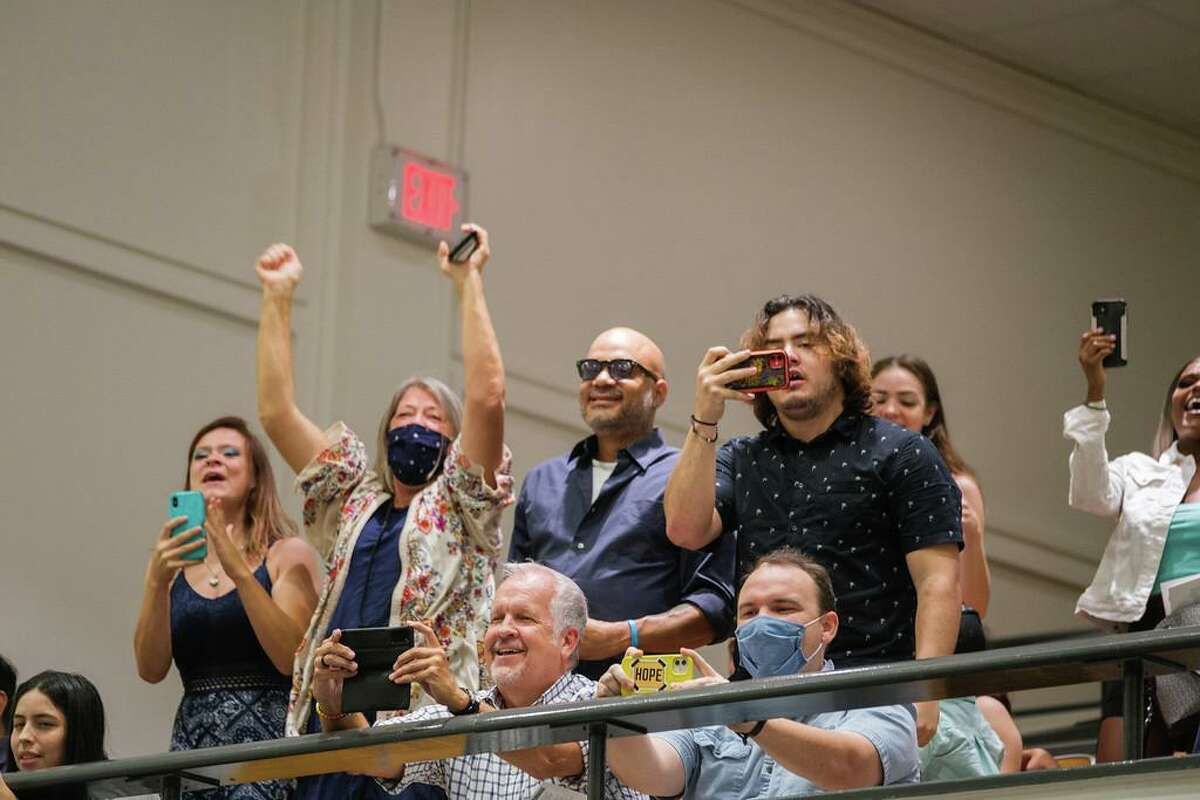Family members cheer and and take pictures as students cross the stage to get their diplomas during Spring Branch ISD's summer graduation ceremony at the Spring Branch Education Center on Aug. 5.
