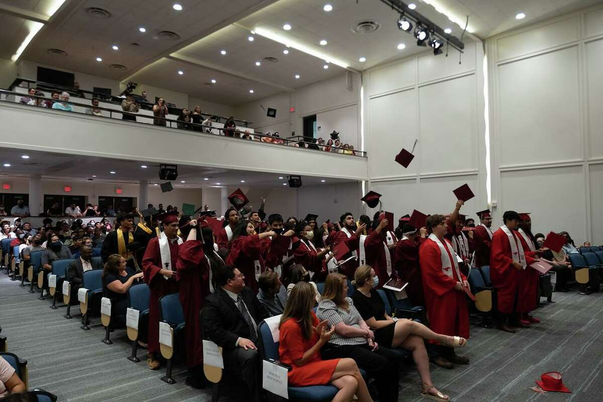 Graduates toss their caps at the conclusion of Spring Branch ISD's summer graduation ceremony at the Spring Branch Education Center on Aug. 5.