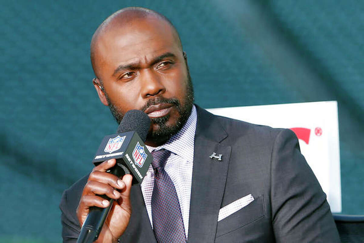 This Sept. 14, 2017, file photo shows NFL analyst Marshall Faulk speaking during a pre-game show before an NFL football game between the Cincinnati Bengals and the Houston Texans, in Cincinnati.