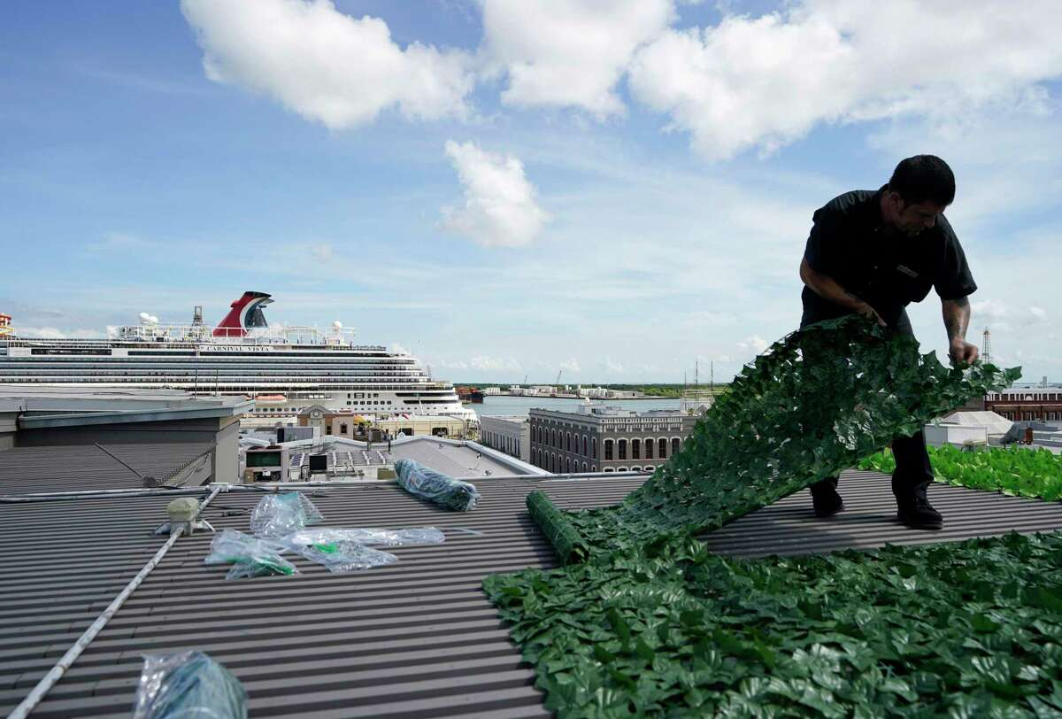 The Carnival Vista is shown at the Port of Galveston as A.J. Ites, with maintenance and engineering, attached artificial foliage on top of the pergola on The Rooftop at The Tremont House, 2300 Ship Mechanic Row St., Friday, July 2, 2021 in Galveston. The Carnival Vista was the first cruise to sail out of Galveston since the pandemic.