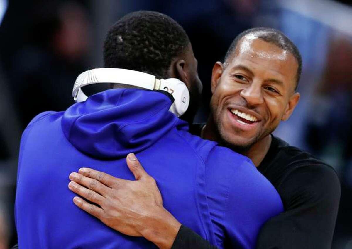 The Heat's Andre Iguodala greets former Warriors teammate Draymond Green in 2020.