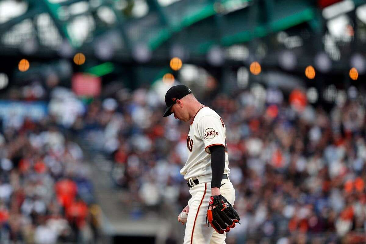 Anthony DeSclafani (26) on the mound in the third inning after giving up 4 runs as the San Francisco Giants played the Los Angeles Dodgers at Oracle Park in San Francisco, Calif., on Wednesday, July 28, 2021.