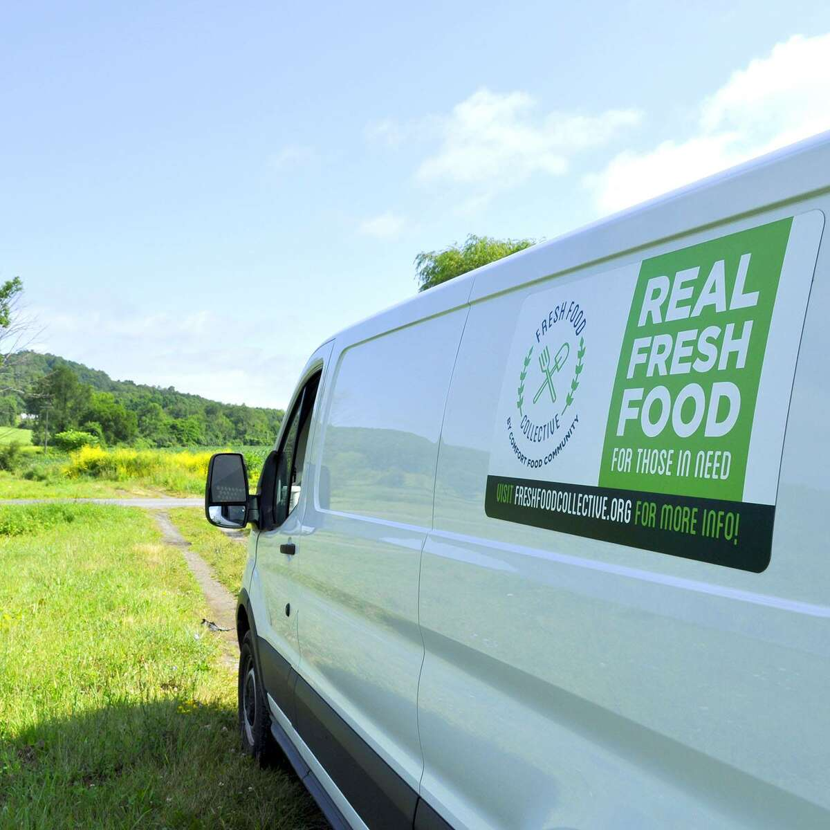 Comfort Food Community's Fresh Food Collective van ready to load up produce at a local farm.