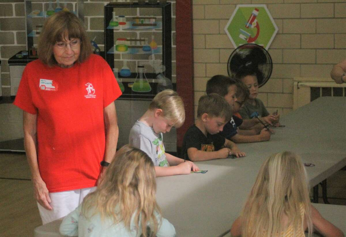Students enjoy the crafting station at Trinity Lutheran Church's Vacation Bible School in Manistee on Thursday.