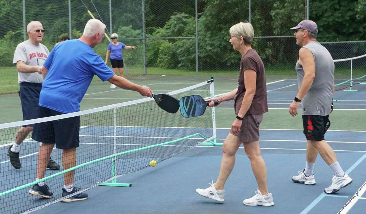 As is the case with all athletic competition, sportsmanship is the underlying raison d'êtrein pickleball as well. (Pioneer photo/Joe Judd)
