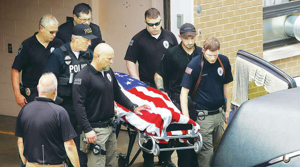 Brooklyn Police Officer Brian Pierce Jr., 24, headed home Friday with a send off from police officers and first responders from across the region. Pierce was struck and killed by a car fleeing police on the McKinley Bridge early Wednesday morning; no arrests have been made. - John Badman|The Telegraph