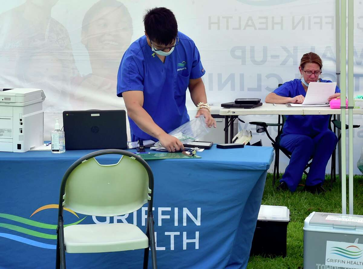 Griffin Health employees at a vaccination center on the New Haven Green Friday.