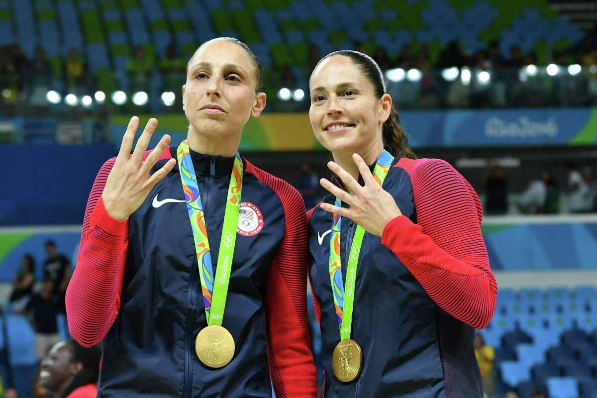 Team USA's Diana Taurasi, left, and Sue Bird pose with their gold medals after the women's basketball final during the 2016 Summer Olympics in Rio de Janeiro.