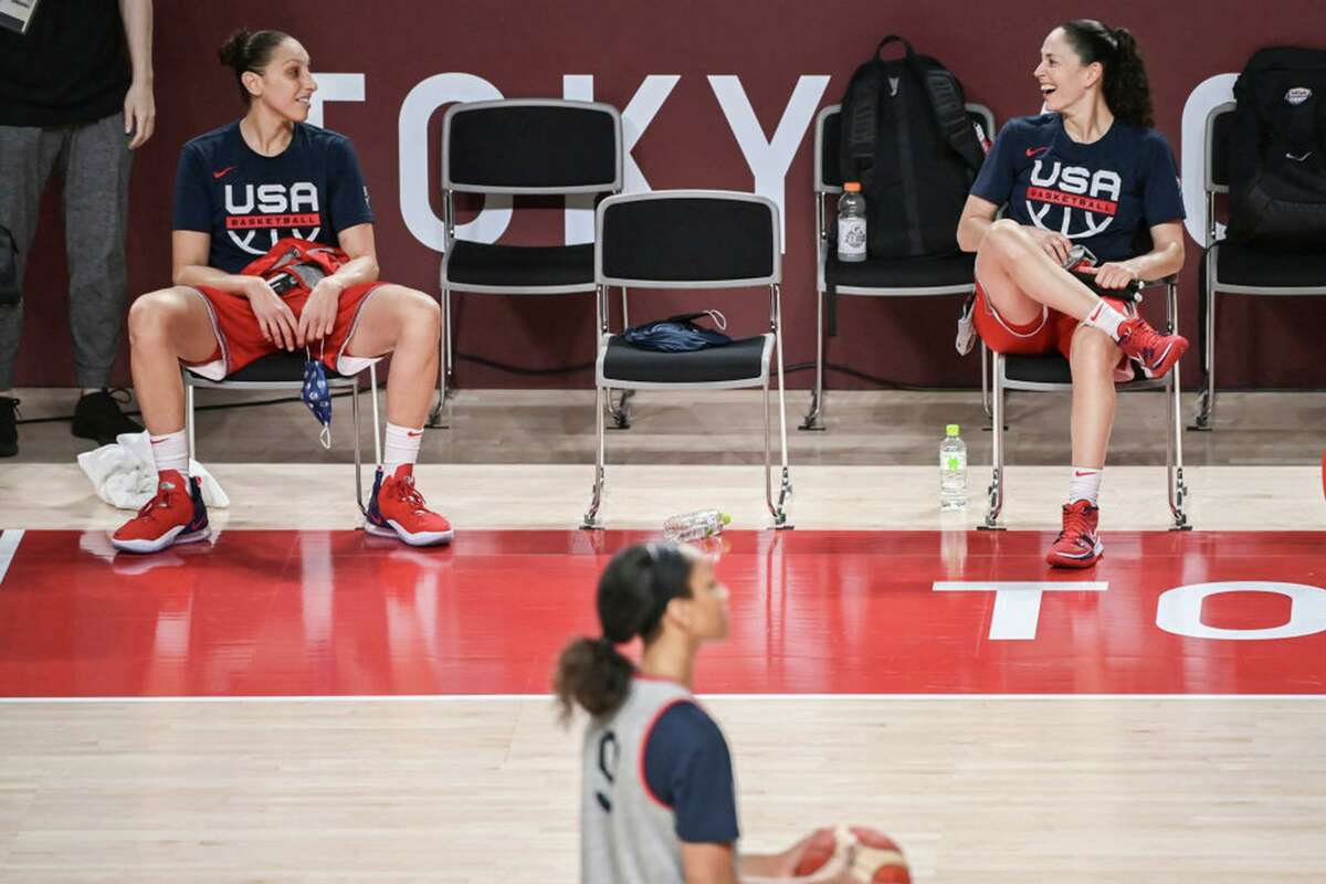Team USA's Sue Bird, right, and Diana Taurasi talk during a training session at the Tokyo Olympic Games.