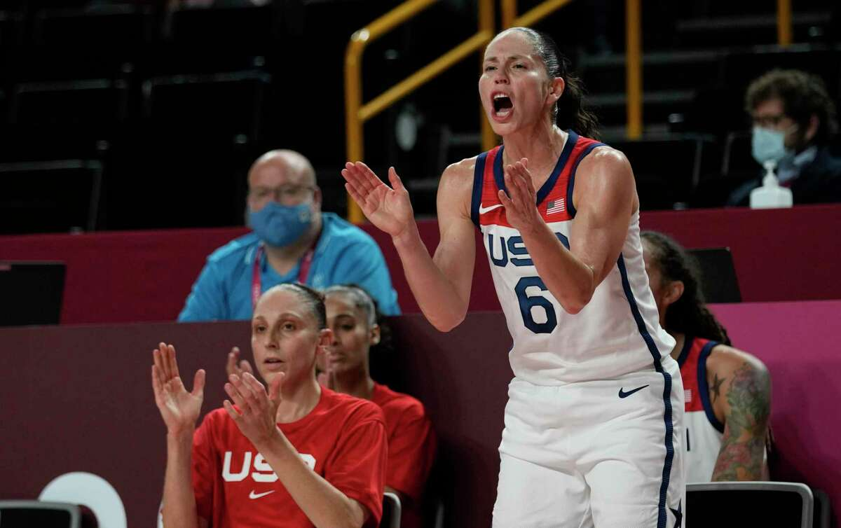 Team USA's United States' Sue Bird (6) and Diana Taurasi cheer from the bench during the women's basketball semifinal game against Serbia at the 2020 Summer Olympics on Friday.