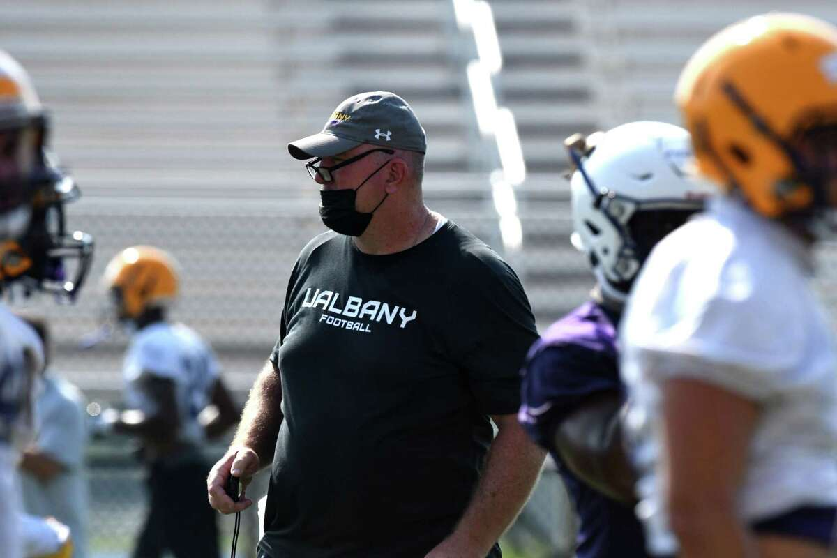 University at Albany football head coach Greg Gattuso works with players during the first practice of the season on Friday, Aug. 6, 2021, at Tom and Mary Casey Stadium in Albany N.Y. The team's first home game takes place Saturday, Sept. 11, against Rhode Island. They face North Dakota State on the road on Sept. 4.