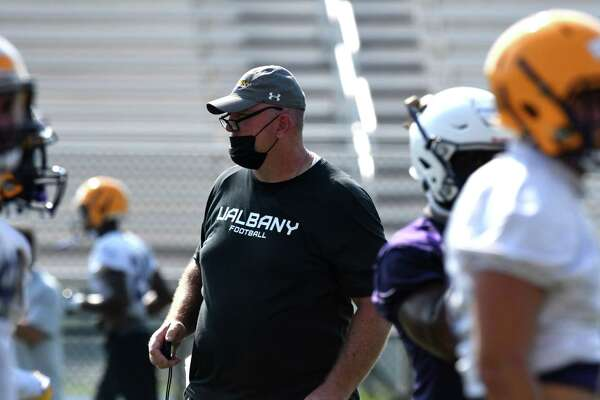University at Albany football head coach Greg Gattuso works with players during the first practice of the season on Friday, Aug. 6, 2021, at Tom and Mary Casey Stadium in Albany N.Y. The teams?• first home game takes place Saturday September 11 against Rhode Island. They face North Dakota State on the road on September 4.