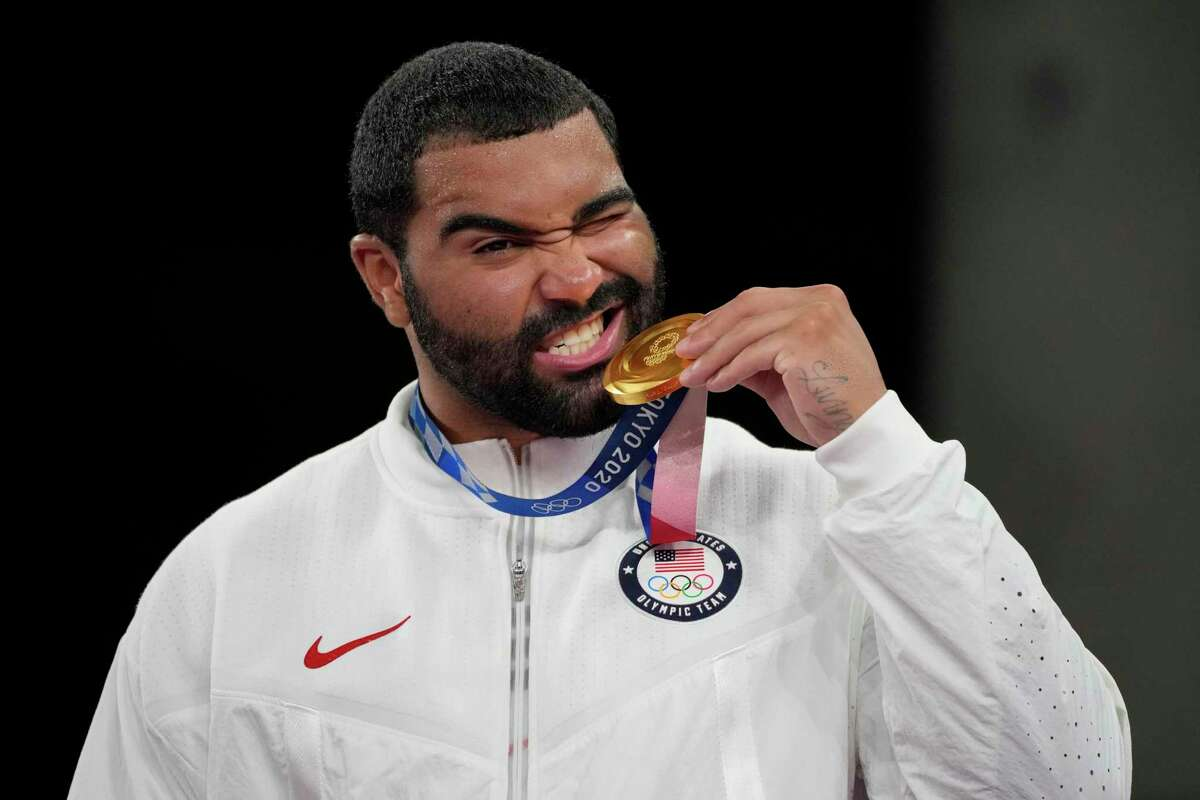 United State's Gable Dan Steveson celebrates with his gold medal during the victory ceremony for men's freestyle 125kg wrestling at the 2020 Summer Olympics, Friday, Aug. 6, 2021, in Chiba, Japan. (AP Photo/Aaron Favila)