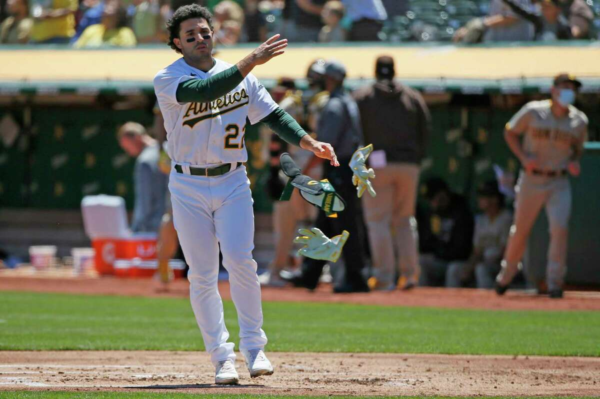 Oakland Athletics right fielder Ramon Laureano (22) throws his batting gear after striking out against the San Diego Padres that ends the first inning during an MLB game at RingCentral Coliseum on Wednesday, Aug. 4, 2021, in Oakland, Calif.