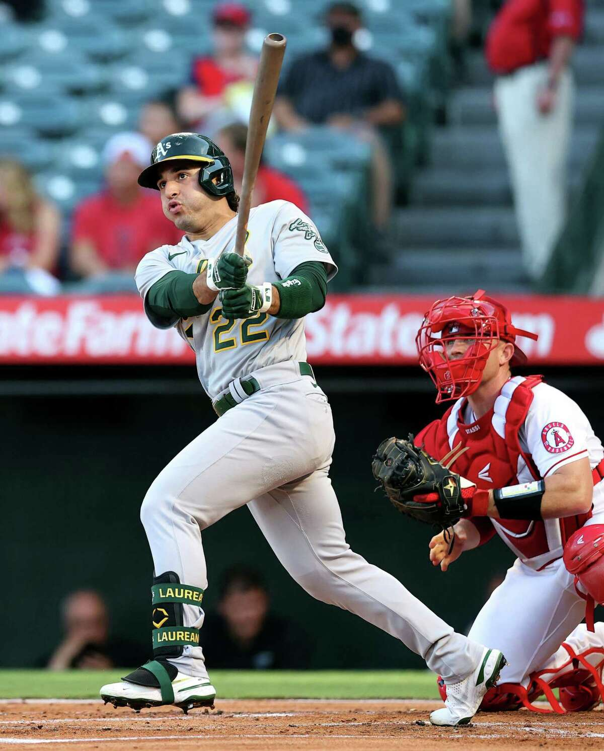 ANAHEIM, CALIFORNIA - JULY 29: Ramon Laureano #22 of the Oakland Athletics hits a double against the Los Angeles Angels in the first inning at Angel Stadium of Anaheim on July 29, 2021 in Anaheim, California. (Photo by Ronald Martinez/Getty Images)