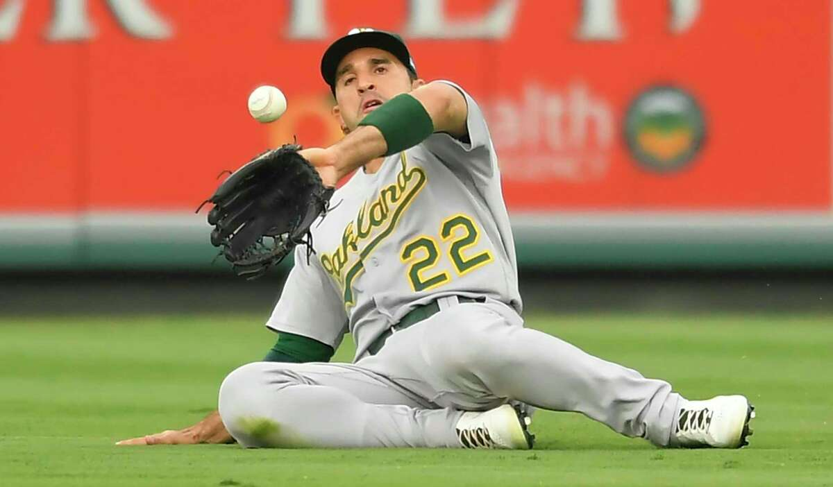 Oakland Athletics center fielder Ramon Laureano catches a fly ball hit by Los Angeles Angels' Phil Gosselin during the first inning of a baseball game Friday, July 30, 2021, in Anaheim, Calif. (AP Photo/John McCoy)