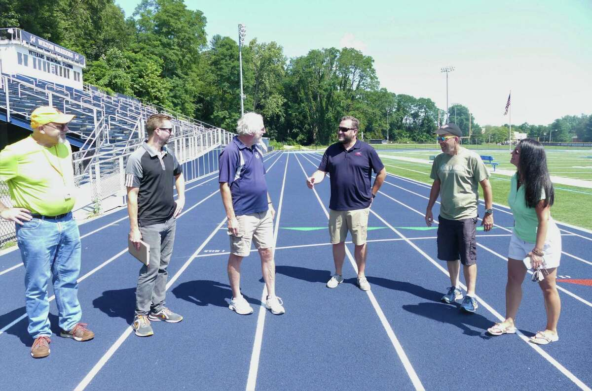 Parks and Recreation Director Steve Pierce, third from left, and Parks and Recreation Commission Chairman Anna Marie Bilella, right, did a final walkthough on Friday to approve the project that was started on June 21.