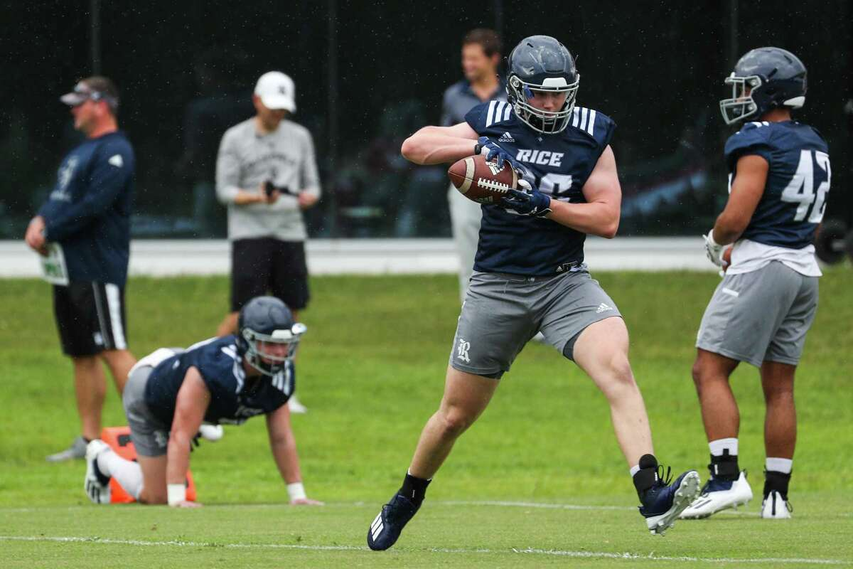 Rice tight end Connor Welsh makes a catch during practice Friday, Aug. 6, 2021, in Houston.