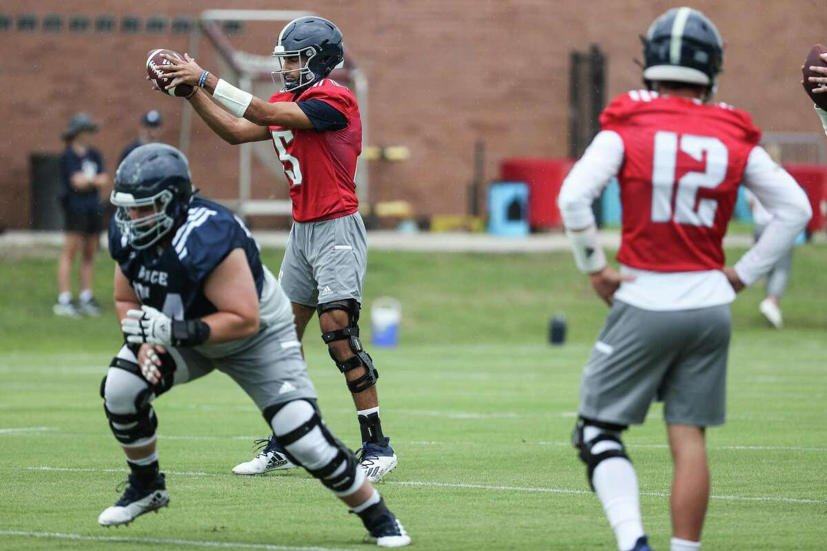 Rice quarterback Shawqi Itraish (15) takes a snap during practice Friday, Aug. 6, 2021, in Houston.