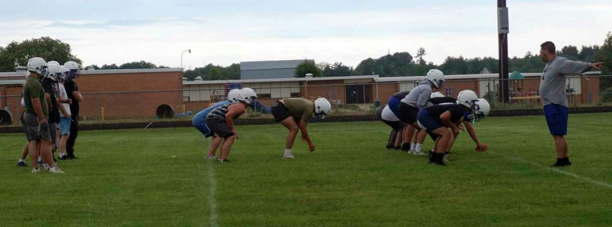 Morley Stanwood football coach Art Campione (far right) directs his players during a mini camp workout this summer. (Pioneer file photo)