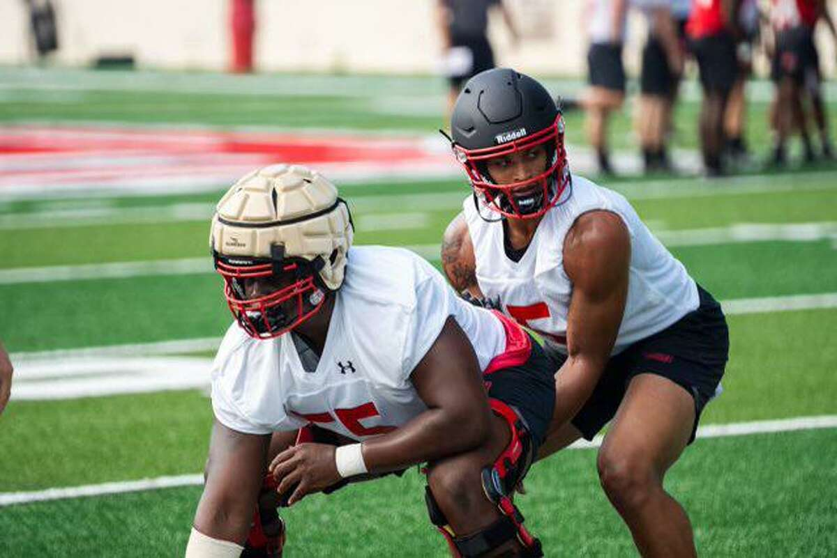 The Lamar University football team started its fall camp on Friday as the Cardinals prepare for a new season. Quarterback Jalen Dummett takes a snap.