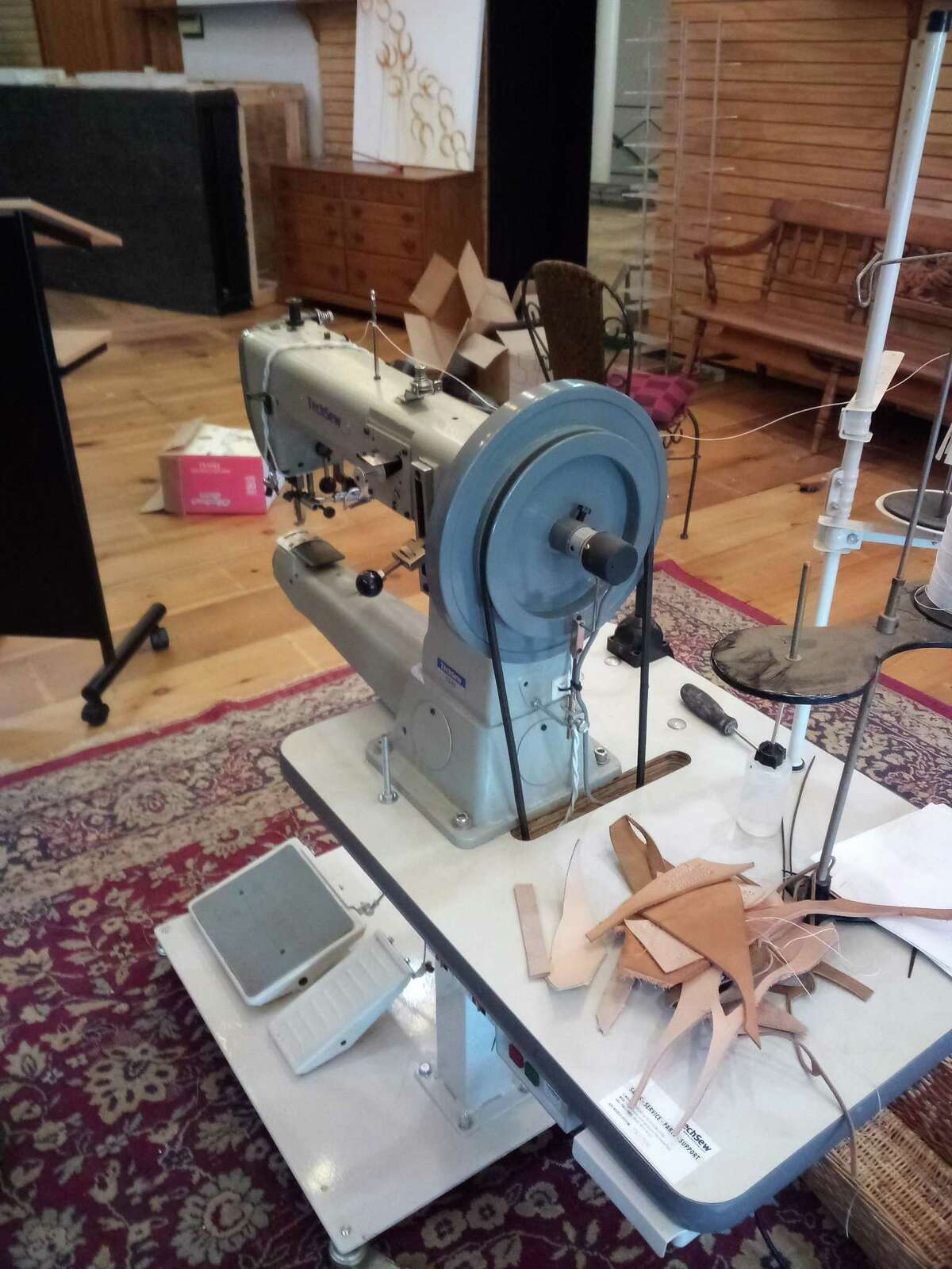 John Noelke's plans to use the Howard building on Main Street as a bookstore and art gallery is moving forward, with an opening planned for September. Pictured is a leathercraft sewing machine, which was recently donated.