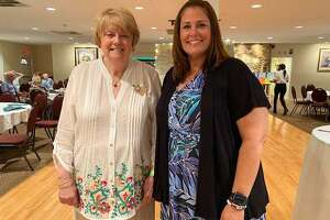 The Woman's Club of Danbury/New Fairfield recently raised $11,000 at a Silent Auction. Pictured are: Janet Jabieski, chair of the Woman's Club's Community Improvement Committee, and Kristy Zaleta, principal of Rogers Park Middle School in Danbury.