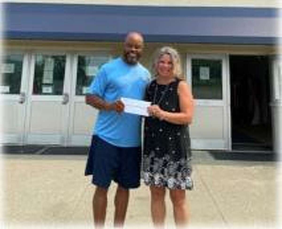 The Danbury Police Activities League (PAL) has been awarded a $15,000 grant from the Union Savings Bank Foundation for the league's Summer Fun and Experience program. Pictured are the foundation's Executive Director Michele Bonvicini presenting the check to the league's Executive Director Vince Jackson.