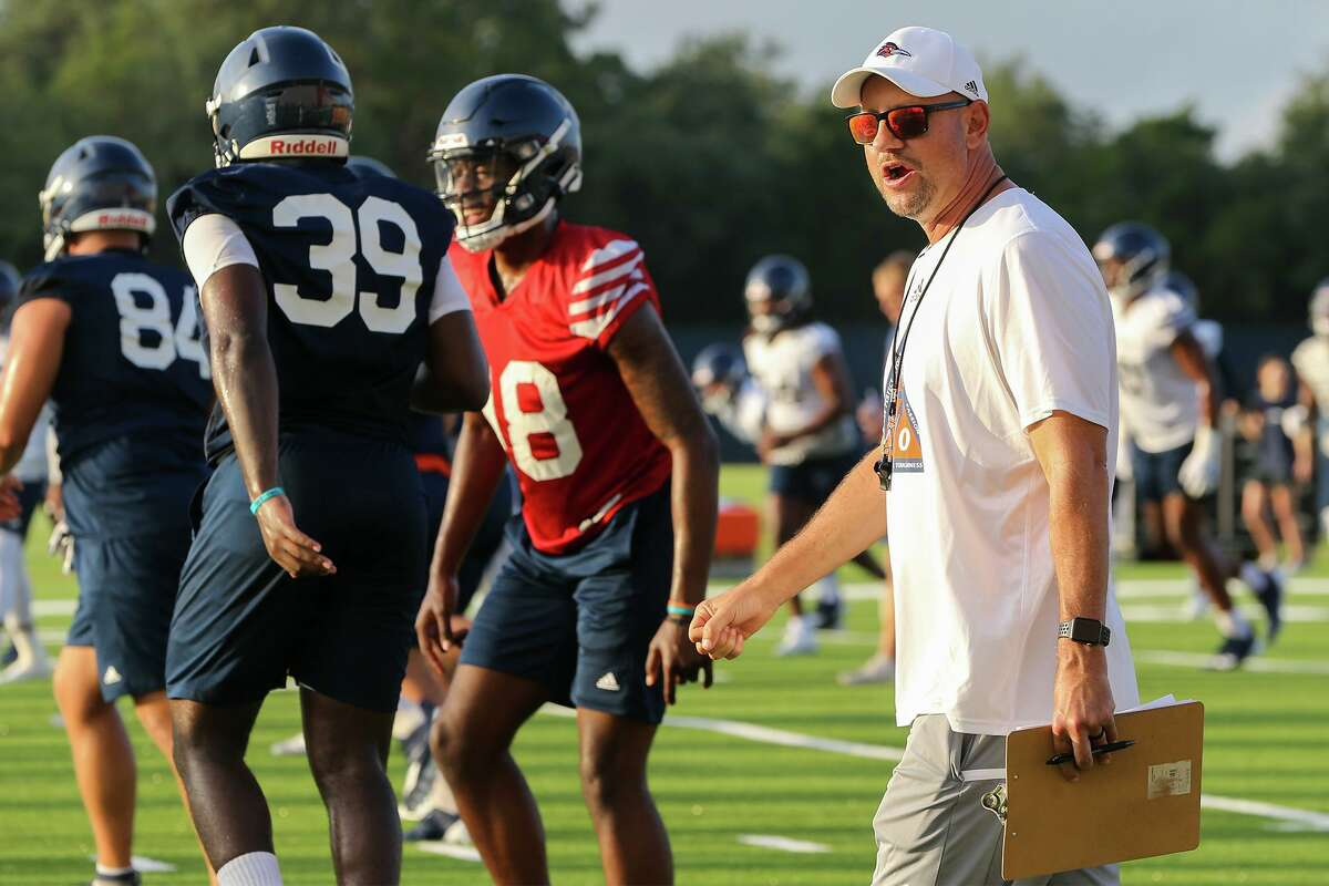 UTSA head coach Jeff Traylor walks between groups during their first football practice of fall camp at the practice fields of the RACE facility on campus on Friday, Aug. 6, 2021.