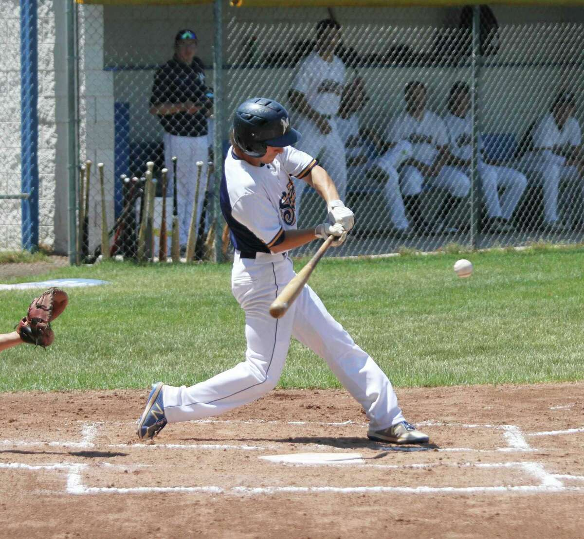 In this file photo, Manistee's Lucas Weinert looks to put the ball in playing during a game at Rietz Park in Manistee. The Saints dropped their first game since June to the Addison Braves of Illinois via a walk-off home run in extra innings Friday during the National Amateur Baseball Federation World Series tournament in Battle Creek. (File photo)