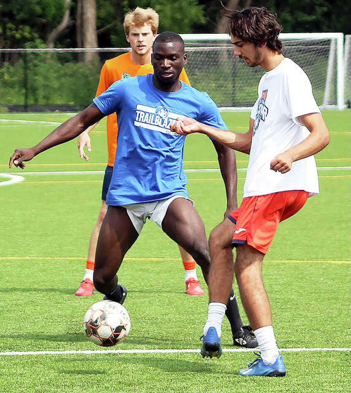 Nsonga Jovanny, a freshman from France, left, controls the ball during LCCC men's soccer practice Thursday on the artificial turf at Godfrey's Glazebrook Park.