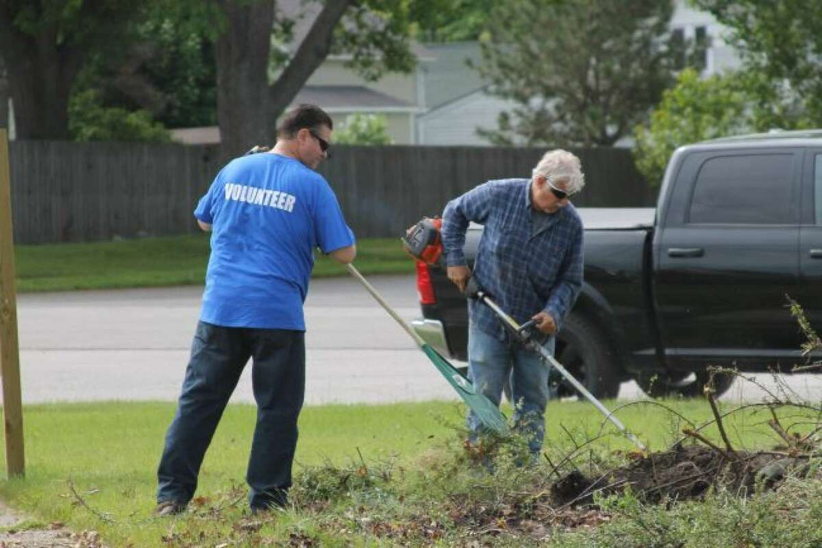 Volunteers work on the Wagoner Community Center grounds in 2019. The Manistee County Council on Aging, which operates the center, counts on volunteers to help with several of its ongoing programs.