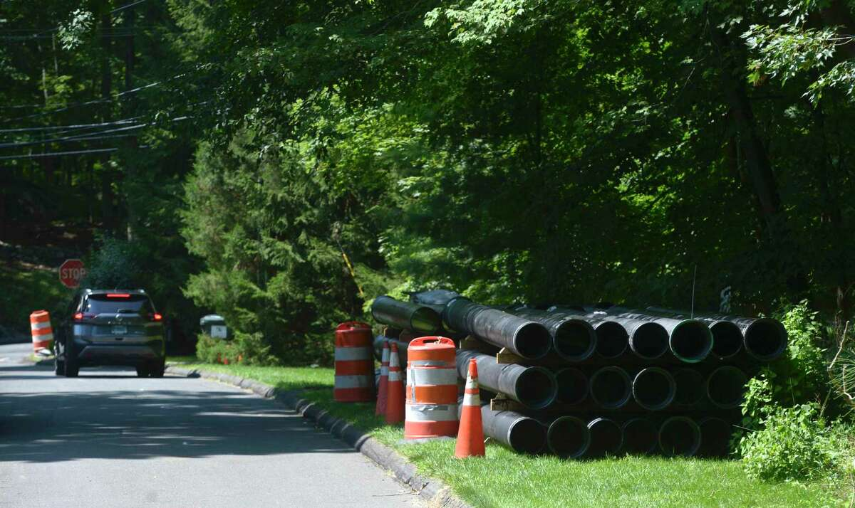 Aquarion will begin work Monday to replace more than a mile of water main on West Mountain Road and Peaceable Ridge Road on the west side of town. The project is aimed at improving system reliability and is expected to be completed by June 2022. Pictured, pipes for the water main replacement stack up on Eleven Levels Road in Ridgefield, Conn. Friday, August 6, 2021.