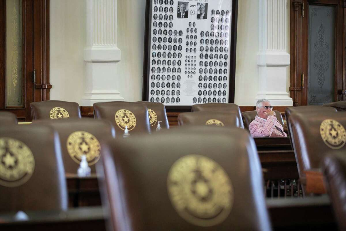U.S. Rep. Dan Huberty (R-TX) sits among empty chairs in the Texas House Chamber on July 13, 2021 in Austin, Texas. The Texas House voted to arrest Democrats who fled the state to deny a quorum in protest of Republicans' controversial voting bill.