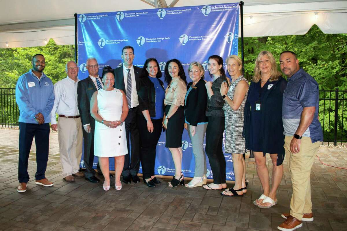 Thomaston Savings Bank President & CEO, members of the Board of Directors, and officers join a group of Hartford County grant recipients. From left are D'Andre Esposito, Bristol Boys and Girls Club; Mark DiVenere, Board of Director, Thomaston Savings Bank, Bristol Boys and Girls Club; Anthony Mattioli, VP, Senior Commercial Lender, Thomaston Savings Bank; Cheryl Lindstrom, Officer, Community Outreach Officer, Thomaston Savings Bank; Stephen Lewis, President, CEO, Thomaston Savings Bank; Tamara Bross, Bristol Boys and Girls Club; Rebekah Stokes, SVP, CFO, Thomaston Savings Bank; Susan Sadecki, Board of Director, Thomaston Savings Bank, Bristol Boys and Girls Club; Keleigh Courtney, Bristol Boys and Girls Club; Coral Richardson, Imagine Nation; Doreen Stickney, Imagine Nation; Jay Maia, Bristol Boys and Girls Club.