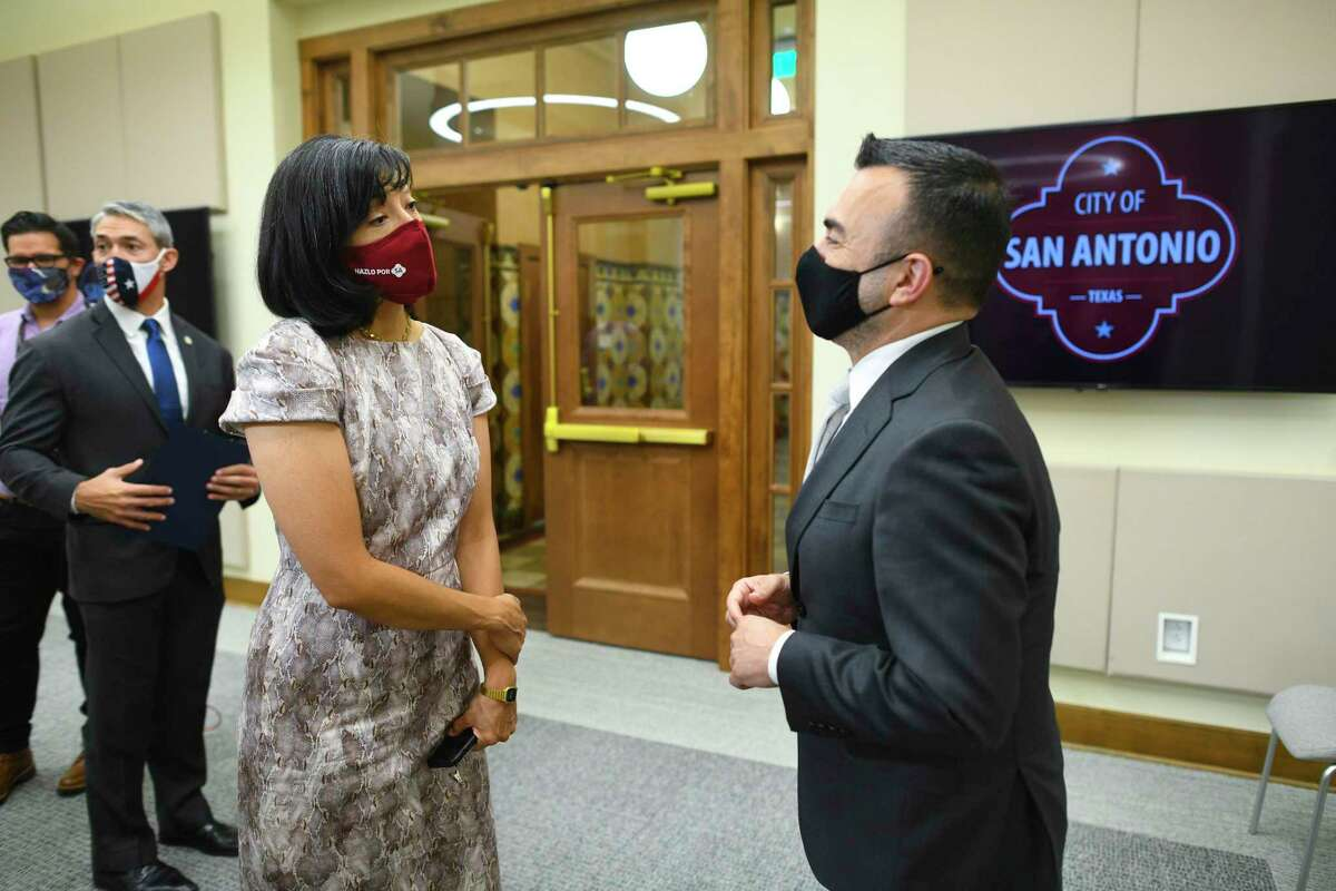 White House Vaccinations Coordinator Dr. Bechara Choucair, right, speaks with San Antonio City Councilwoman Ana Sandoval at City Hall on Friday.