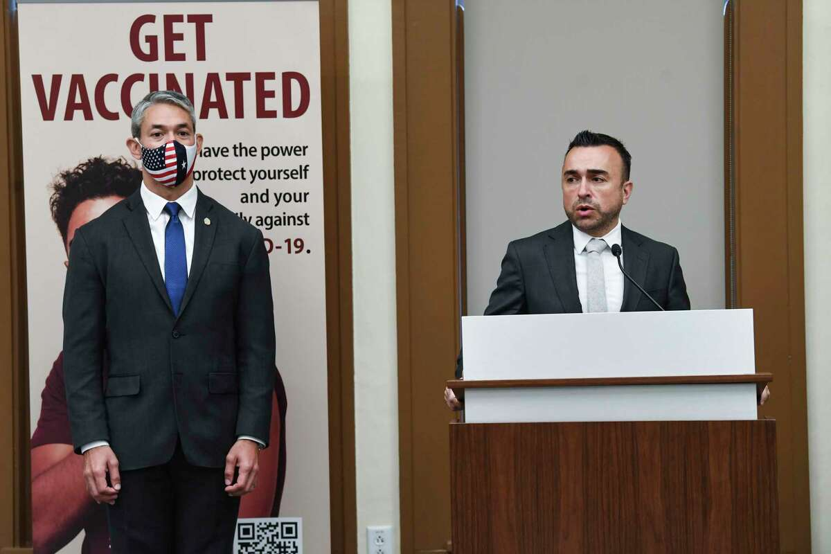 White House Vaccinations Coordinator Dr. Bechara Choucair speaks as San Antonio Mayor Ron Nirenberg listens at City Hall on Friday.