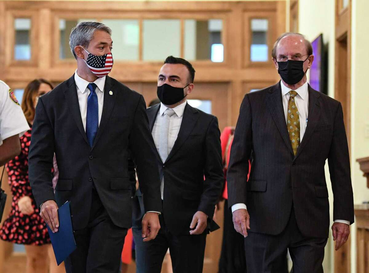 San Antonio Mayor Ron Nirenberg, left, White House Vaccinations Coordinator Dr. Bechara Choucair, middle, and Bexar County Judge Nelson Wolff walk in City Hall as they prepare to speak about COVID-19 vaccinations Friday.