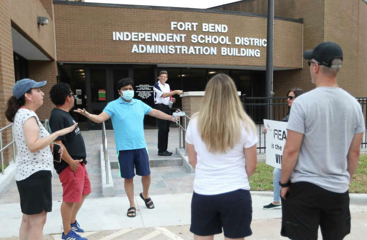 A small group of parents gathered on Aug. 4, 2021, outside the Fort Bend ISD administration building to ask the school board to not approve a mask mandate.