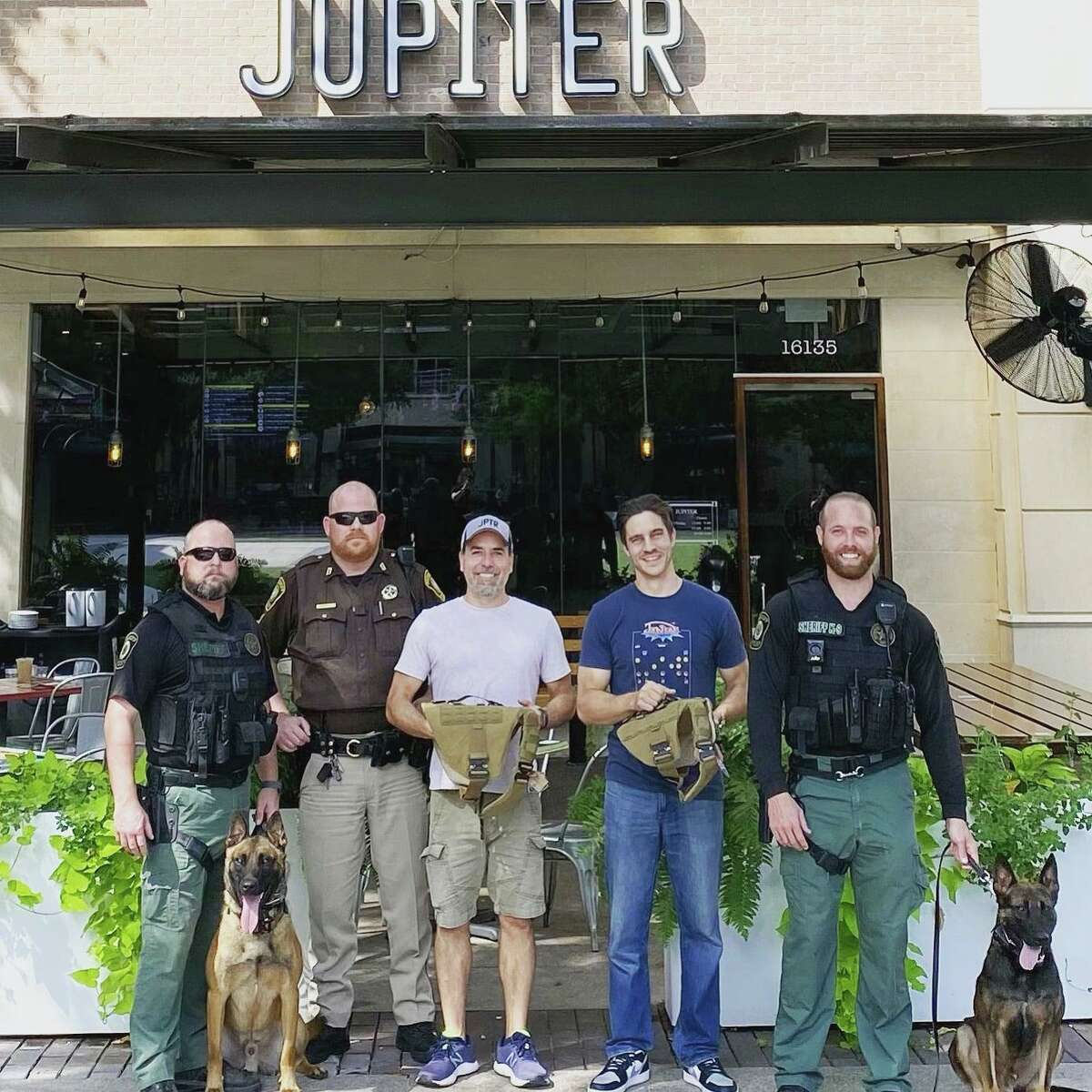 Pictured from left are Fort Bend County Sheriff's Office Deputy Mangum; K9 Durko; Sgt. Hricko; Jupiter Pizza owners Robert White and Victor Litwenko; Deputy Cloud; and K9 Urko.