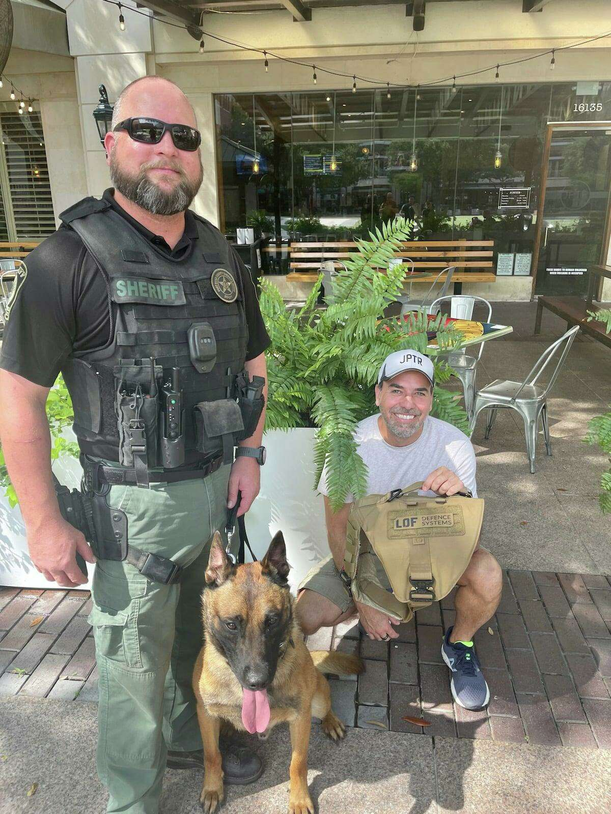 Fort Bend County Sheriff's Office K9 unit received armored vests from area business owners Robert White and Victor Litwinenko.