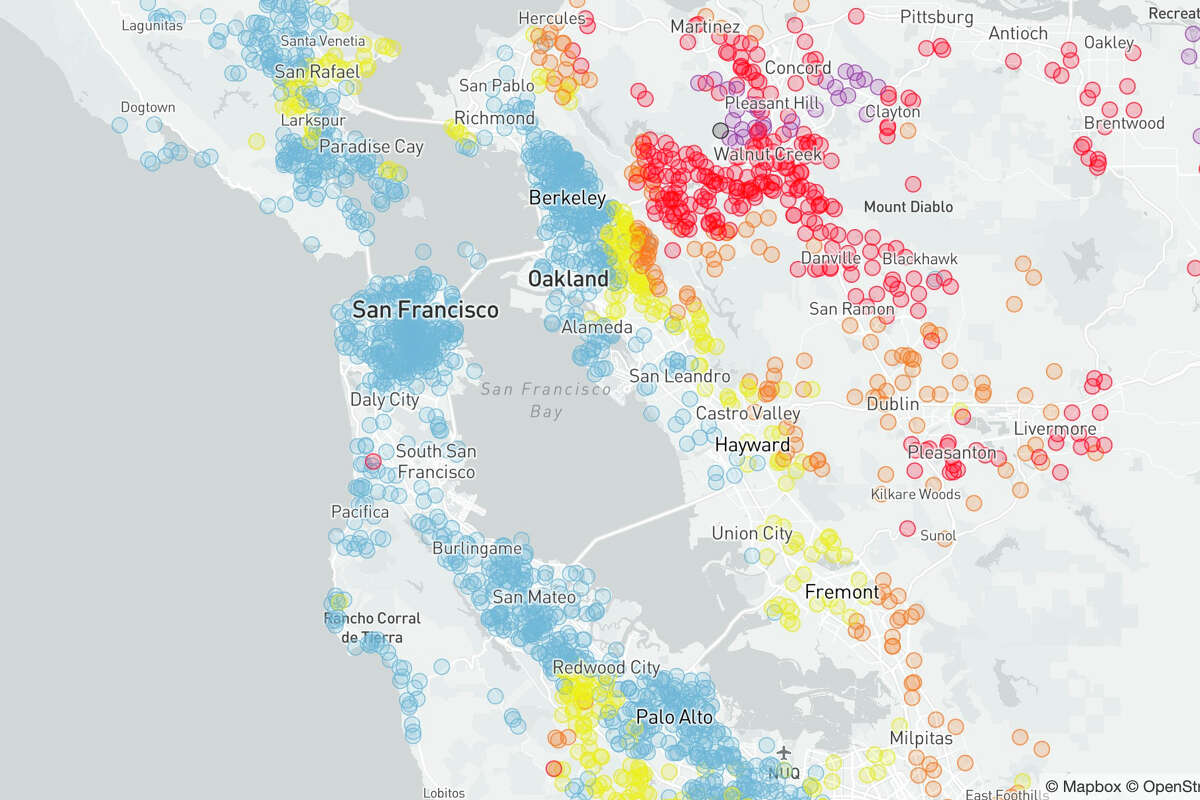 Air quality across the Bay Area, as of Friday evening. Blue shaded regions are 'good' air quality, orange are deemed 'unhealthy for some,' and red to purple are 'unhealthy for all' to 'very unhealthy.'