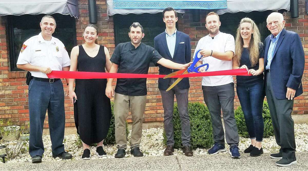 Mediterranean Flavors Bar & Grill in Middletown celebrated a grand opening Aug. 3. From left are South District Fire Chief James Trzaski, Penelopi Matosi, co-owner and chef Theodoros Dimitrakopoulos, Mayor Ben Florsheim, co-owner chef Vasileios Gkauos, Maria Staikopoulos, and Middlesex County Chamber of Commerce President Larry McHugh.
