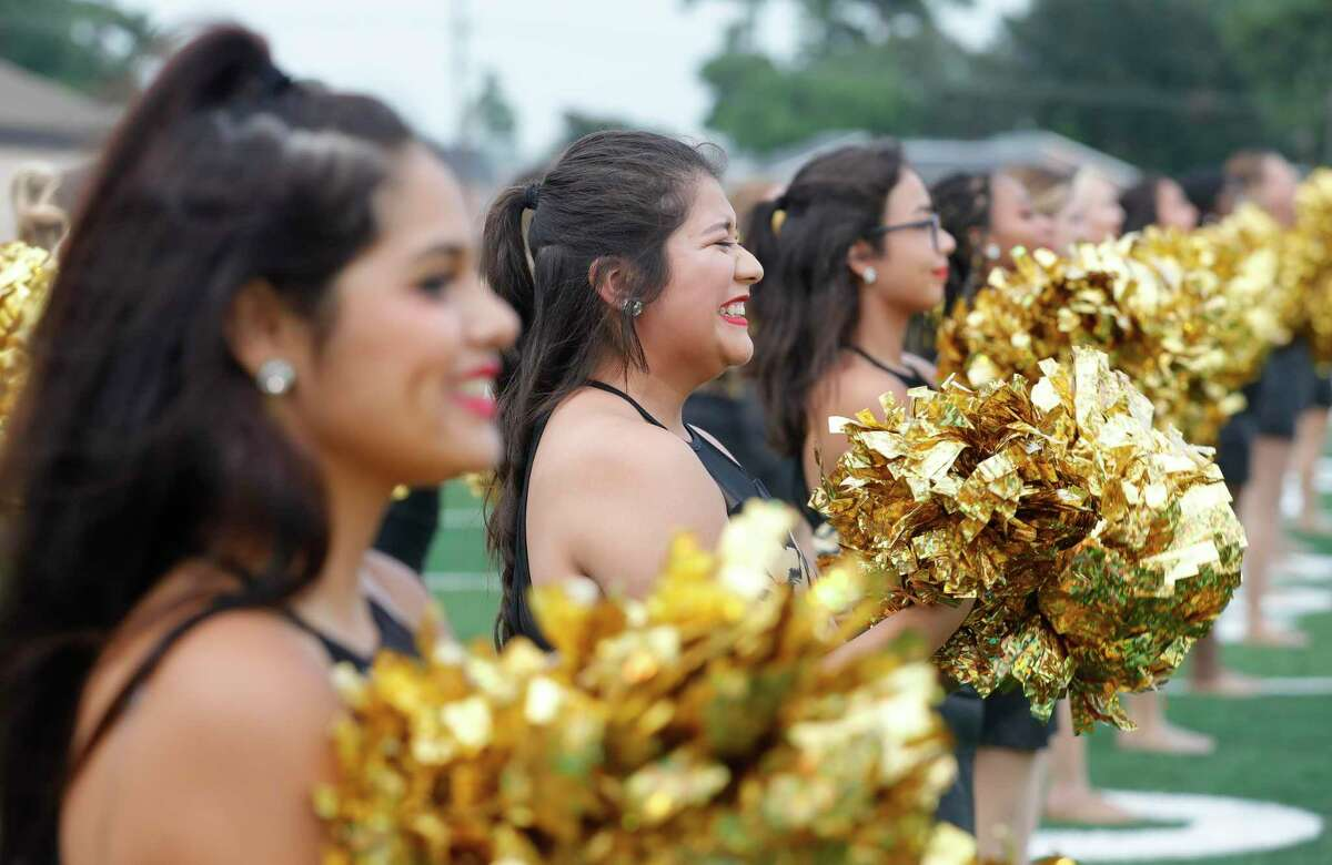 Members of the Golden Girls dance team are seen during Meet the Tigers at Moorhead Stadium, Friday, Aug. 6, 2021, in Conroe. Community members saw performances by the Conroe High School's band, Golden Girls, cheerleaders and stayed to watch the football team practice under the lights.