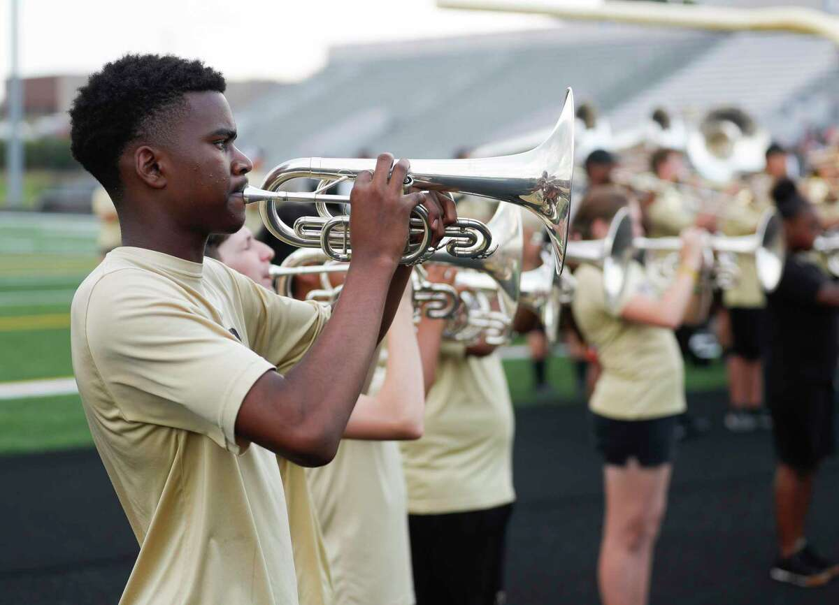 Zach Gregory warm up before Meet the Tigers pep rally at Moorhead Stadium, Friday, Aug. 6, 2021, in Conroe. Community members saw performances by the Conroe High School's band, Golden Girls, cheerleaders and stayed to watch the football team practice under the lights.
