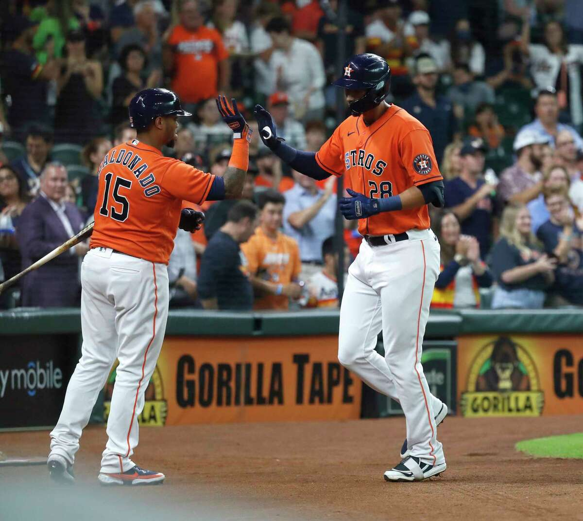 Houston AstrosTaylor Jones (28) celebrates with Martin Maldonado (15) after he hit a two-run home run off of Minnesota Twins starting pitcher Bailey Ober (82) during the second inning of an MLB baseball game at Minute Maid Park, Friday, August 6, 2021, in Houston.