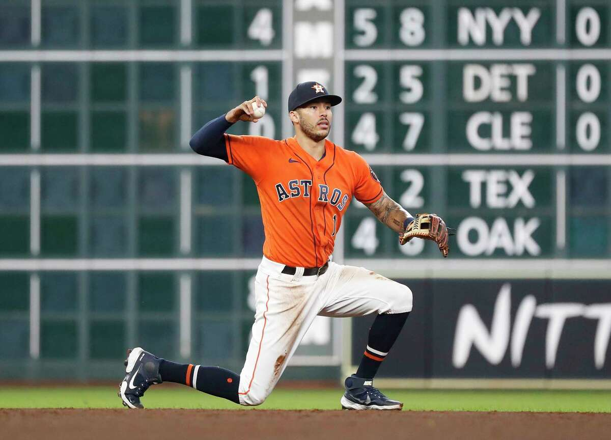 Houston Astros shortstop Carlos Correa (1) after catching Minnesota Twins Luis Arraez's line out during the second inning of an MLB baseball game at Minute Maid Park, Friday, August 6, 2021, in Houston.