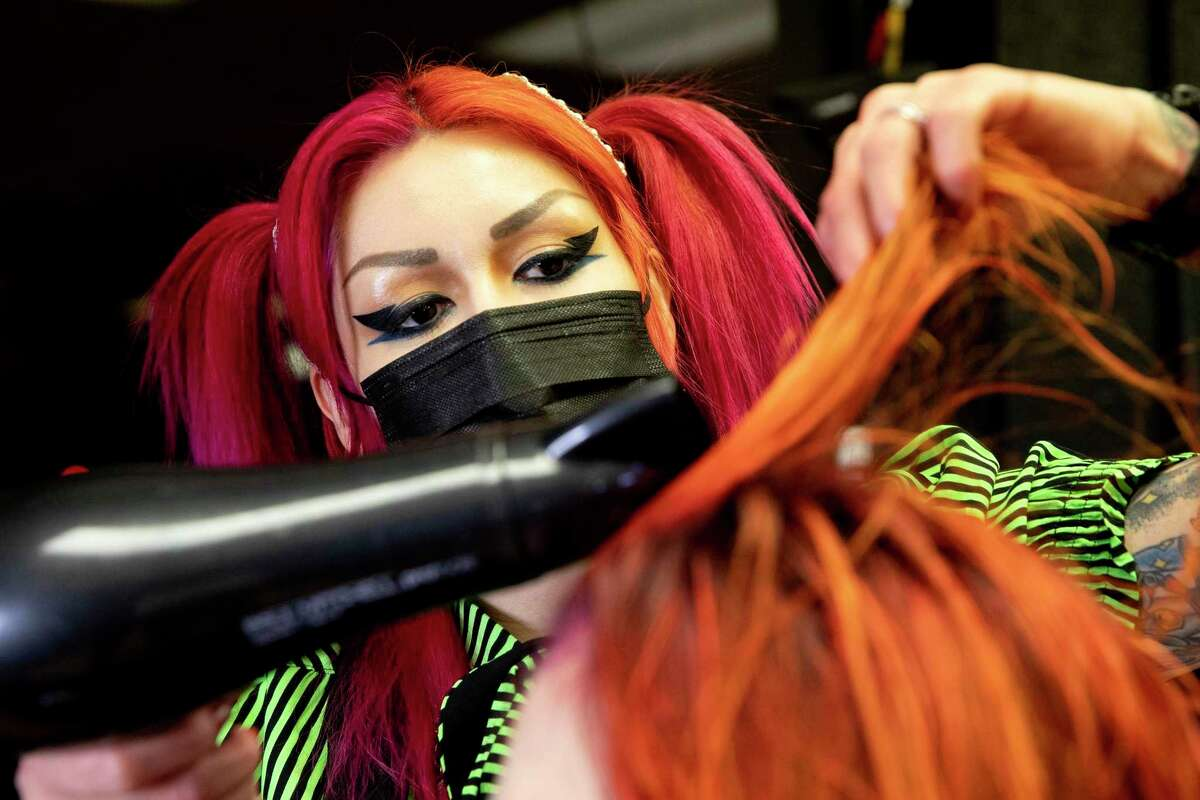 Crystal Duron, better known as Crystal Terror, works on the hair of longtime client Crystal Forsythe at Toxic Salon. Duron specializes in edgy haircuts and coloring for her customers.