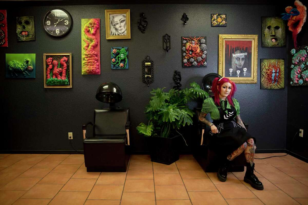 San Antonio hairstylist and horror artist Crystal Terror (née Duron) sits in front of her artwork at Toxic Salon, her hair-styling business she founded in 2014.
